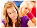 תמונה של תלמידות כותבות מבחן